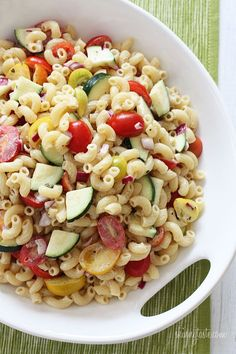 The perfect light summer pasta salad loaded with fresh tomatoes and zucchini  in a light creamy dressing.