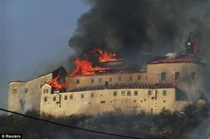 Up in smoke: A fire rips through the Krasna Horka castle, near Roznava, eastern Slovakia, after police suspect a discarded cigarette lit dry grass nearby Castle Burn, Gothic Castle, Medieval Castle, Schengen Area, Up In Smoke, Central Europe, Bratislava, 14th Century, Capital City