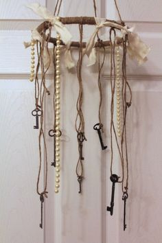Relax to the soothing tones of antique keys wafting in the breeze with this Shabby Chic Chandelier/Wind Chime.  Metal vintage key decor look