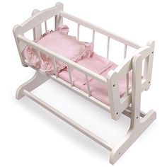 Stir your childs imagination with this pretty doll cradle. The cute pink gingham material and painted white wood will complement the design scheme of your childs room. It can hold dolls up to 20-inches long or multiple smaller dolls.