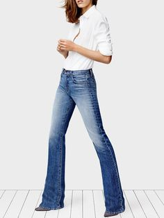 Simple white button up, boot-cut jeans and grey suede heels.  @WhoWhatWear