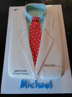 - White Coat celebration cake for a Pharmacy graduation. Two layer 9 x 13 cake with buttercream frosting and marshmallow fondant.