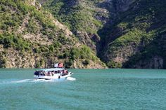 Hiking in Albania The Dragobia setting out across Lake Koman towards Fierzë. Image by Tom Masters / Lonely Planet Albania Travel, Visit Albania, Travel Deals, Travel Tips, Interesting Buildings, Day Hike, Lonely Planet, Hiking Trails, Backpacking