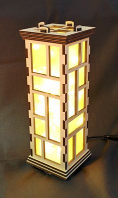 34cm tall lantern. Squished up inside is a 10 metre string of LED lights, powered by a mains adaptor.