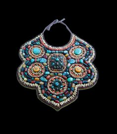India ~ Ladakh | Ceremonial Ibuk (Scapak) Gorget; embroidered on a padded cotton ground with turquoise, coral, agate, mother of pearl, and sandalwood beads | Zanskar Valley, mid 20th century | £850