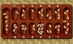 Dig a wari board into the sand and play with beach pebbles