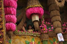 "Pahiyas means ""decor"" and every May 15, the fronts of houses in Lucban, Philippines are elaborately decorated with a brightly colored rice wafer, called kiping."