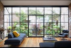 Industrial Design Homes Window - the industrial design for homes room is mostly filled with windows that lead directly to the outside plants that decorate the house. Patio Interior, Home Interior Design, Interior Architecture, Interior And Exterior, Interior Modern, Interior Decorating, Casa Loft, Exposed Brick, Home And Living