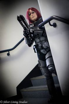 Myself cosplaying as N7 armour female Commander Shepard from the Mass Effect video game trilogy. Photo taken by Giles Warhurst at Silver Lining Studios (https://www.facebook.com/pages/Silver-Lining-Studios/1564999847103681?fref=photo) https://www.facebook.com/EdukiCosplay