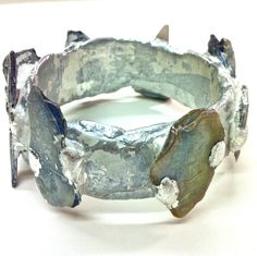 papier-mache bangle with shards of mother of pearl from the foreshore of the river thames - gilded with silver leaf - hilary bravo