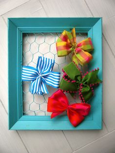 chicken wire hair bow organizer.  And add some hooks at the bottom for headbands.