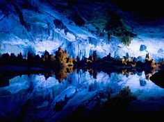Reed Flute Cave.Gilin China. It has plants growing near the entrance that are made into reed instruments. Sometimes nature proves you simply don't need Photoshop
