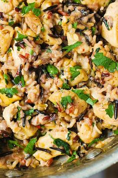 Chicken & Wild Rice in a creamy Parmesan sauce – easy and delicious! I love chicken and wild rice casserole, and this recipe is just like a casserole but everything is cooked on a stove top!  The crea