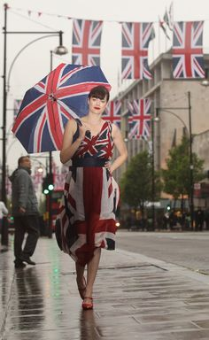 Fashion designer and model Jasmine Guinness poses near the 147 union flags flying above Oxford Street, in celebration of the forthcoming Diamond Jubilee of Her Majesty Queen Elizabeth II, on May 1, 2012 in London, England. The display of flags, entitled the 'Great British Fashion Flag Showcase', represent 147 years of fashion for the world famous high street.