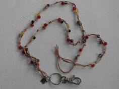 Avainnauha #7 by Miss Piggy / Key chain, ID holder, made with crackled glass beads and nylon cord