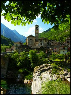 """Ticino - Lavertezzo, Switzerland. Village mostly known for its """"Ponte dei Salti"""", otherwise mistakenly called a Roman bridge, is a preferred spot for sunbathers, swimmers and divers. The village church is also worth a visit. Dating back to the 18th century, it has typically baroque characteristics."""