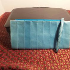 "DKNY bkue learher wristlet or clutch Beautiful blue wristlet/clutch bag by DKNY.  Measures 10"" by 5.5 "" DKNY Bags Clutches & Wristlets"