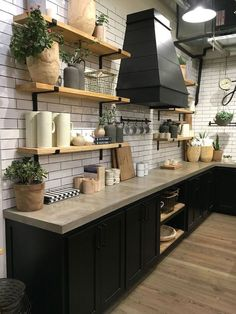 Rustic farmhouse fixer upper kitchen. White subway tile, black lower cabinets, no uppers, natural wood shelves, concrete countertop #ad #kitchendecor #nouppers #blackcabinets #subwaytile #concretecounter