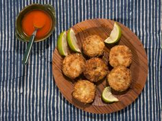Fonio, a variety of millet, gives these West-African-inspired crab cakes a satisfyingly crisp crust. Finger Food Appetizers, Finger Foods, Appetizer Recipes, Fresh Lime Juice, Fresh Ginger, Crab Cake Recipes, Red Palm Oil, Lime Wedge, Crab Cakes