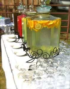 Will have 2 drink dispensers, maybe can borrow a 3rd, it looks really nice with the added fruit.  Elegant and Rustic Wedding Idea. (Note from another pinner - use cheese cloth or something like it to put the fruit in inside the jar. AS when it sinks it will clog the dispencer.)