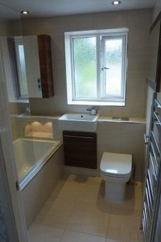 Ideal small bathroom layout only. Sink next to bath. Chrome wall radiator by door. Tiles & colour let it down. Small Bathroom Layout, Small Bathroom Storage, Simple Bathroom, Bathroom Ideas, Bathroom Organization, Small Bathrooms, 1950s Bathroom, Narrow Bathroom, Small Baths