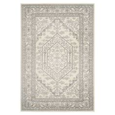 Anchor your living room seating group or define space in the den with this artfully loomed rug, featuring a Persian-inspired motif for classic style.