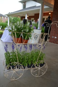 Garden cart holding paper fans for guests at wedding ceremony/reception