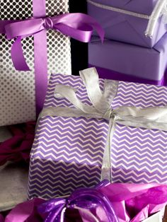 Gift wrap offers another opportunity to incorporate unexpected holiday hues. For a well-layered approach, several patterned papers were chosen, each with a different scale and shape. Break up the monotony of flat paper by wrapping each gift with textured ribbon.