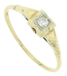 A round sparkling diamond is set in the square face of this 14K yellow gold vintage engagement ring. Triangular shapes on the rings shoulders point out from the central diamond and ripple down the band. This lovely wedding ring measures 5.39 mm in width. Circa: 1940. Size 10 1/4. We can re-size.