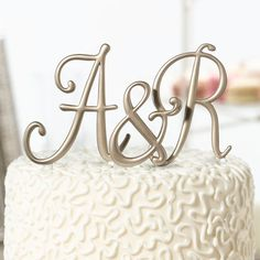 """Dress up your wedding cake with our Gold Monogram Wedding Cake Toppers! These gold plated monograms feature picks at the bottom for sliding into the cake.Size: Each letter stands 5"""" tall."""