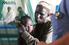 March 21: A father comforts his 4-year-old daughter, who is being treated for malaria at the National Teacher Training Institute outside Juba, South Sudan. Photo: Margaret Aguirre, International Medical Corps, South Sudan 2012