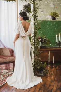 draped wedding dress back - photo by Jason Hales Photography http://ruffledblog.com/leaves-of-grass-wedding-inspiration #weddingdress #bridal #weddinggown
