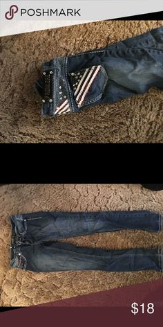 Premiere Jeans Meant to be skinny jeans but I wore them like a Capri. Only worn a few times, in decent condition. A lot of the jewels on the pockets fell off but the flag stitching is still good. Rue 21 Jeans Skinny