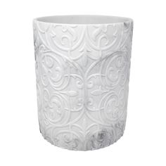 The round shaped Brookline Wastebasket is a stylish bathroom piece crafted in resin material. This wastebasket features a white and gray faux marble look accompanied by a unique embossed pattern. Designed to create an elegant bathroom aesthetic, this piece pairs well with other bathroom essentials from the Brookline Collection.