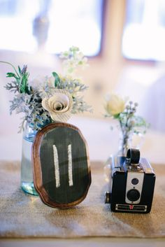vintage camera and chalkboard centerpiece // photo by Shipra Panosian // view more: http://ruffledblog.com/intimate-st-augustine-wedding
