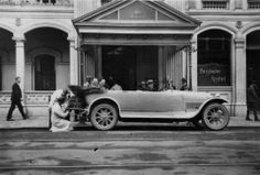 Sporty motor vehicle parked outside the Brisbane Hotel, ca.1930