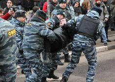 This is a photo of a protester in Moscow who was arrested for repeatedly swearing against Putin.