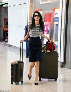 Coming through: Amal Clooney touched down at Heathrow Airport on Thursday afternoon following a four-day work trip to Athens