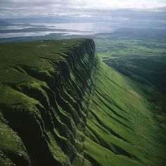 """Benbulbin, sometimes spelled Ben Bulben or Benbulben (from the Irish: Binn Ghulbain), is a large rock formation in County Sligo, Ireland. It is part of the Dartry Mountains, in an area sometimes called """"Yeats Country"""". Benbulbin is a protected site, designated as a County Geological Site by Sligo County Council."""