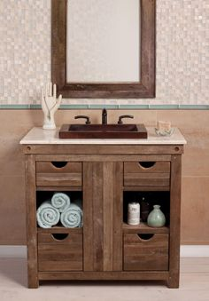 The rustic style of this bathroom sink vanity will add a nice decorative touch to the space. With four drawers and two open shelves there is ample room for storage and organization. A light marble counter top is enhanced with a copper sink bowl with a dark antique finish.