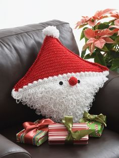 Santa Pillow! This little Santa pillow is sure to bring holiday cheer to any house he visits! Free crochet pattern!