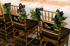 DIY chair back Mr & Mrs signs - learned at our #CapRoWorkshop! Cait & Bill's black and gold, DIY Washington DC wedding at Carnegie Institution for Science | Images: Stephen Gosling Photography