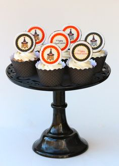 """Gingerbread Cupcakes with Cream Cheese Icing topped with """"Howl-oween"""" Cookies"""