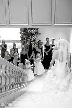 Bridal Party Photo - love this shot of the bridal party's reaction to the bride, fully dressed and ready, coming down stairs