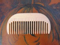 This small wooden comb is ideal for travelling with and for fine hair (where there is lots of it) or medium thickness hair. The comb is 8.5cm long and the tines are 2.5cm deep with 2mm spacing. It is made in Germany with sustainably sourced beech wood.