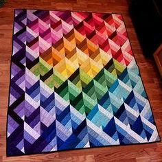 Prism Quilt - 4 Streifen aus Jelly Roll hell nach dunkel zusammennähen, dann den Block in diagonale Dreiecke schneiden. Zu senkrechten Streifen zusammennähen (je nach Laufrichtung die hellste bzw. dunkelste Farbe oben) und zum Schluss zum Gesamtquilt nähen.
