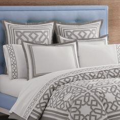 Grey and white bedding scheme by Jonathan Adler