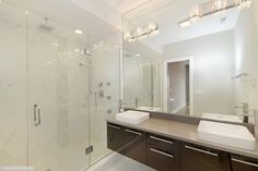 Contemporary Master Bathroom with European Cabinets, Flush, Slate counters, Wall sconce, complex marble floors, High ceiling