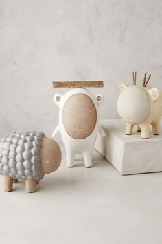 Loveee the little yellow one and white one!!! | Ceramic Critter Piggy Bank - anthropologie.com
