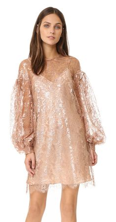 Lavish lace billow tunic dress by Zimmermann. Description NOTE: Zimmermann uses special sizing. Please see Size & Fit tab. Ethereal metallic lace lends a weightles...